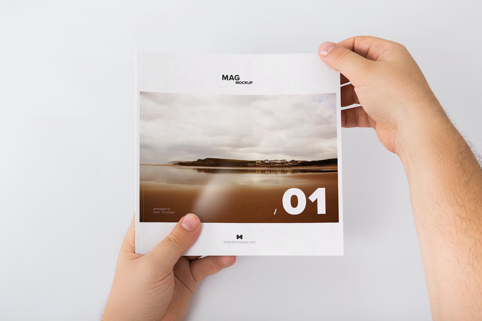 Holding Closed Square Magazine Mockup 01