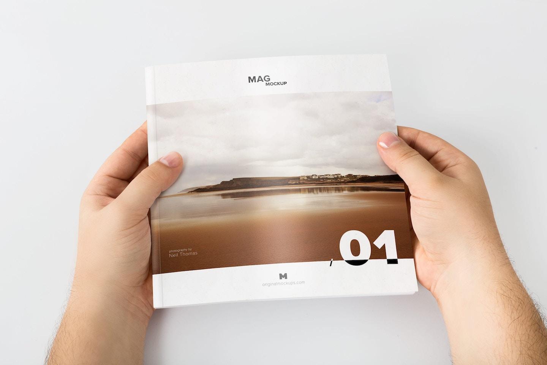 Holding Closed Square Magazine Mockup 02