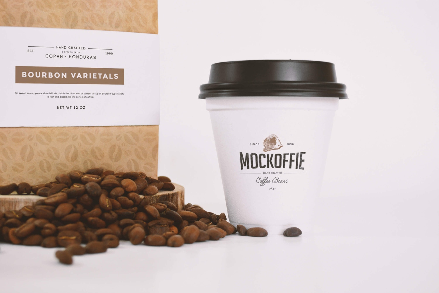 Coffee Bag and Sealed Cup Mockup Close up View by Eduardo Mejia on Original Mockups