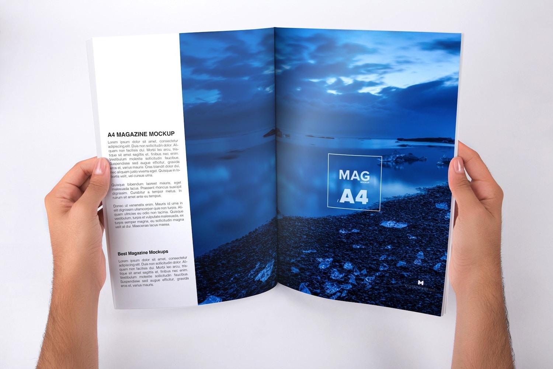 holding a4 magazine opened mockup original mockups